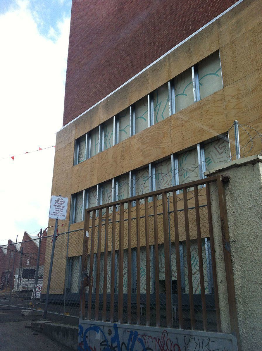 The mural currently covered up for protection while development work begins onsite, September 2012